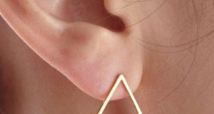 Gold triangle earrings These geometric studs are the perfect addition to any out...